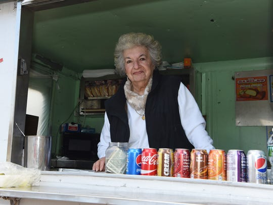 Carole Crusco, owner of Carole's Hot Dogs, stands inside of her food truck off of St. Andrew Road in Hyde Park.