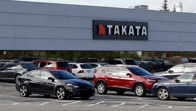 FILE - This Oct. 22, 2014, file photo, shows the Takata building, an automotive parts supplier in Auburn Hills, Mich. On Tuesday, May 19, 2015, Takata doubled the size of its air bag recall to 33.8 million air bags, making it the largest recall in U.S. history. The air bags can inflate with too much force, sending metal shrapnel into drivers and passengers. So far the problem has caused six deaths, including five in the U.S. (AP Photo/Carlos Osorio, File)