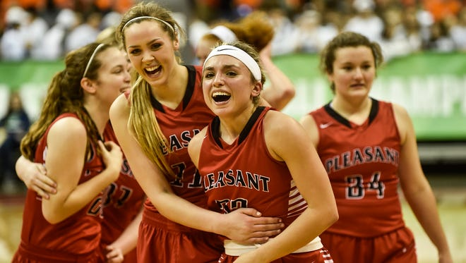 Summer Blevins, left, and Kamryn Kimmel celebrate with their teammates after Pleasant's 50-47 state semifinal win over Gates Hills Gilmour Academy. They play Africentric Saturday at 10:45 a.m. for a state championship in Division III.