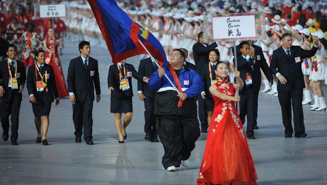 In this file photo, Ricardo Blas Jr. leads his team at National Stadium in Beijing during opening ceremonies of the Beijing 2008 Olympic Games.