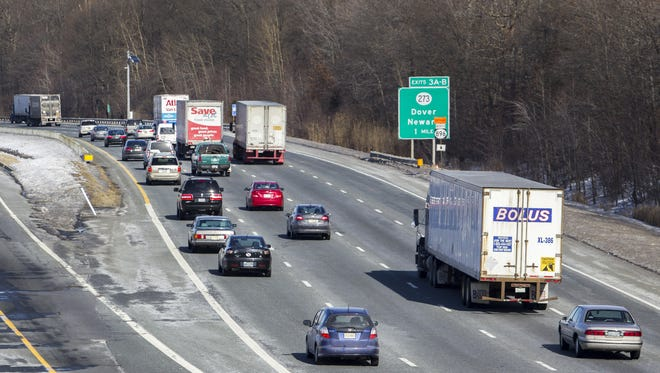 Traffic moves along Interstate 95 near the Newark rest stop on Feb. 24, 2015. Taking a job driving a chemical truck in the U.S. can earn you a signing bonus of as much as $5,000.