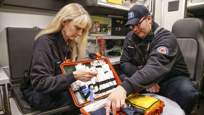 Indianapolis EMS paramedic Linda Hodge-McKinney and EMT Ryan Marcoux talk about the different supplies and tools they carry on their ambulance on Friday, March 31, 2017.