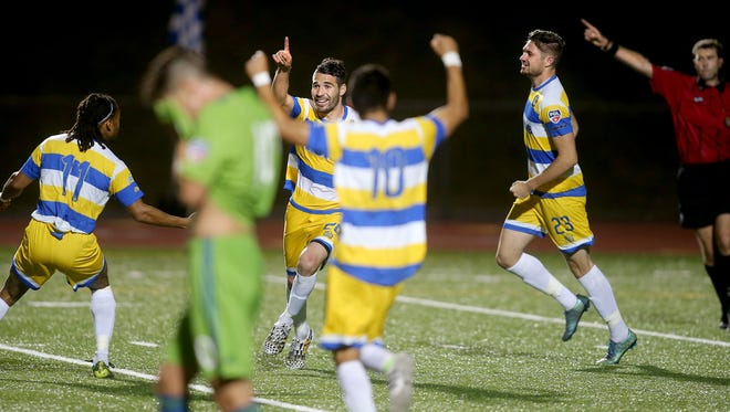 Javier Castro Gonzalez, center, of the Kitsap Pumas celebrates his goal during a U.S. Open Cup game against the Sounders FC U-23s at Silverdale Stadium in 2016. The Pumas are back in the Open Cup again this year.