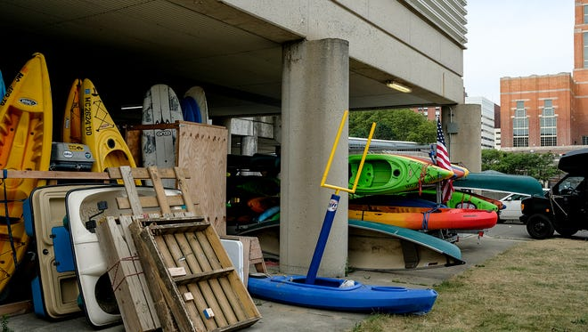 River Town Adventures uses a storage area under the Lansing Center. Tuesday, July 31, 2018.
