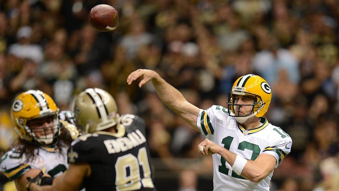 Green Bay Packers quarterback Aaron Rodgers (12) makes a pass against the New Orleans Saints during Sunday night's game at the Superdome in New Orleans. Evan Siegle/Press-Gazette Media