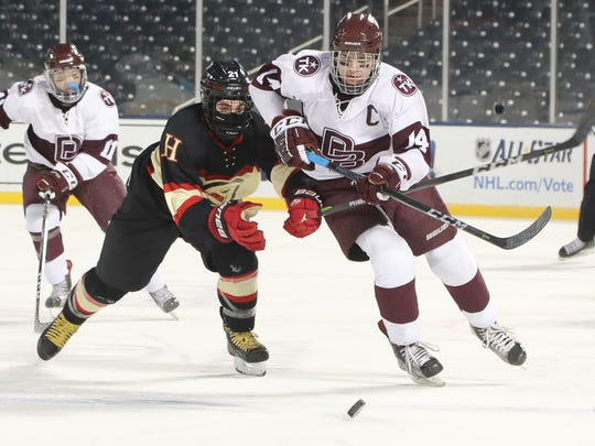John Campomenosi of Don Bosco carries the puck into the offensive zone in the third period.