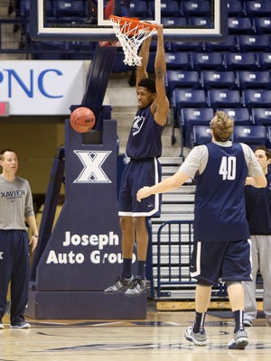Jalen Reynolds dunks during Xavier's practice Tuesday morning at Cintas Center.