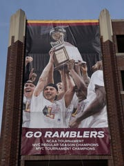 A banners honoring the men's basketball team is on