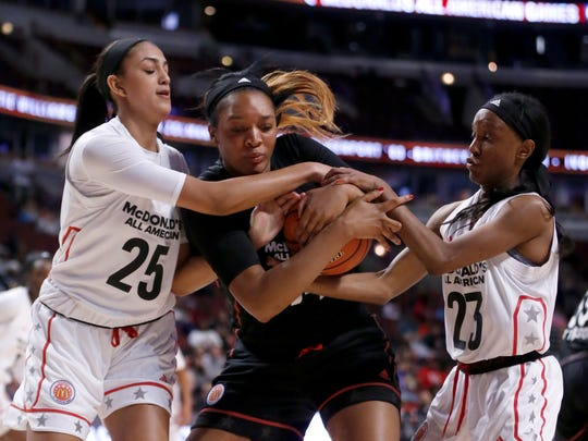 """The West's Jade Williams (25) and Kiana Williams (23) battle the East's Kasiyahna """"Kasi"""" Kushkituah, a Tennessee signee, for the ball during the first half of the McDonald's All-American girls high school basketball game Wednesday, March 29, 2017, in Chicago."""