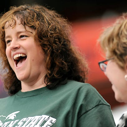 Gayle Withrow, a 1984 MSU graduate from Syracuse, cheers
