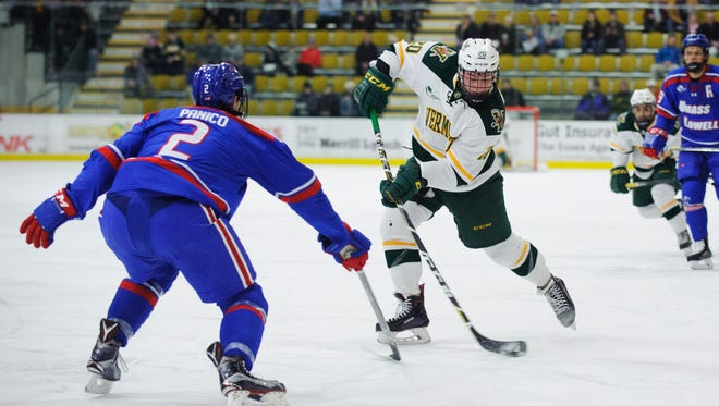 Vermont forward Ross Colton (20) takes a shot during the men's hockey game between the UMass-Lowell River Hawks and the Vermont Catamounts at Gutterson Fieldhouse on Friday night January 19, 2018 in Burlington.