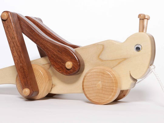 Hand crafted wooden toy from Needles & Nails operated