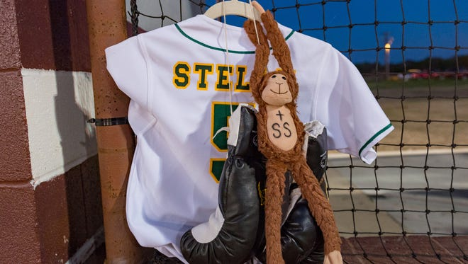 Shae Stelly's jersey hung in Cecilia's dugout during Tuesday's baseball game against Breaux Bridge.