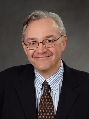 Syndicated columnist E.J. Dionne