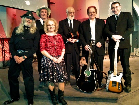 The Johnny Cash Tribute Show Band performs Saturday