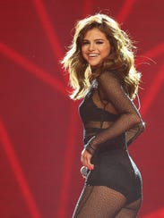Selena Gomez is taking time off to deal with symptoms