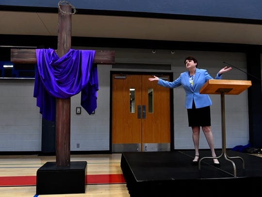 Susan Payne, interim minister at First Christian Church, speaks during the Holy Week service Wednesday at First Baptist Church's Family Life Center.