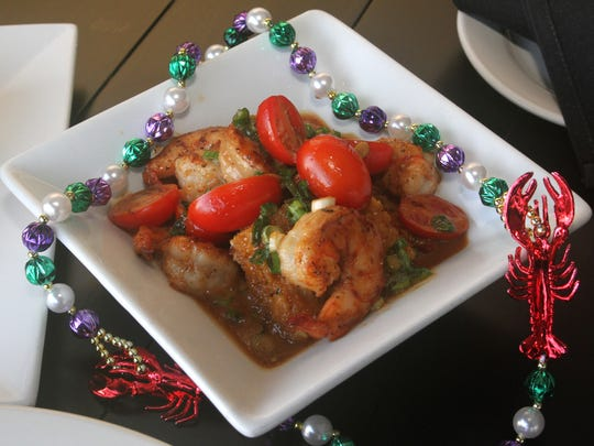 The Voodoo shrimp dish - sauteed shrimp with spicy Worcestershire cream and jalapeño cornbread - is a signature item at Drew's Bayshore Bistro in Keyport.