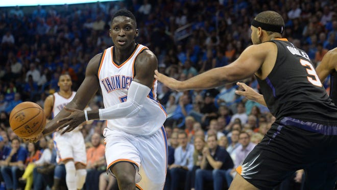 Oct 28, 2016; Oklahoma City, OK, USA; Oklahoma City Thunder guard Victor Oladipo (5) drives to the basket against Phoenix Suns forward Jared Dudley (3) during the second quarter at Chesapeake Energy Arena.