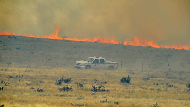 The Viewpoint Fire burns along Highway 89A on May 11, 2018 in Prescott Valley.