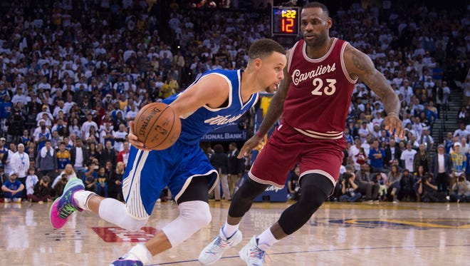 Stephen Curry dribbles against LeBron James in the Warriors' win on Christmas Day.