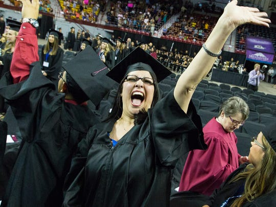 Jessica Lucero waves to her loved ones as she enters the Pan American Center on Thursday, May 12, 2016, during the Doña Ana Community College Commencement at the Pan American Center.