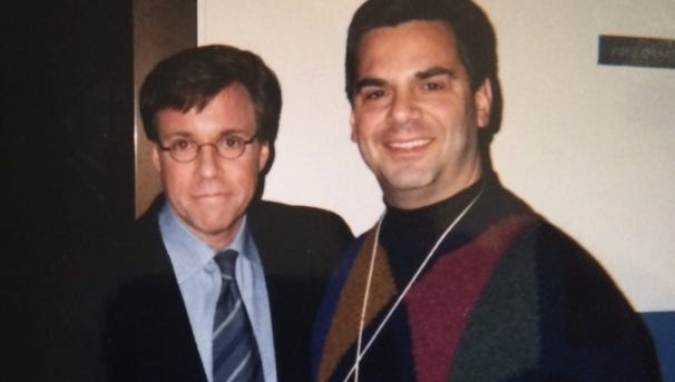 Bob Costas and his new best friend after Game 5 of the 1999 World Series at Shea Stadium.