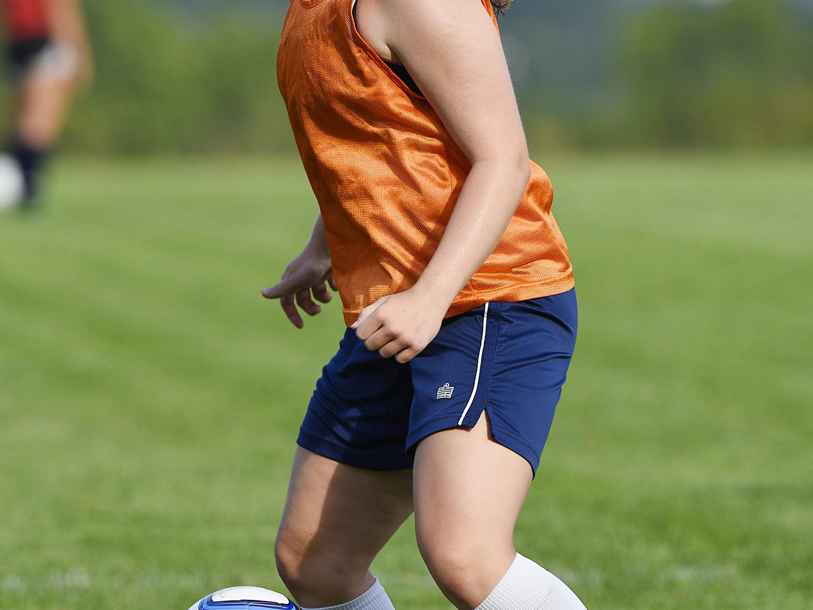 Sartell's Clare Minnerath handles the ball during practice Friday at Sartell High School.