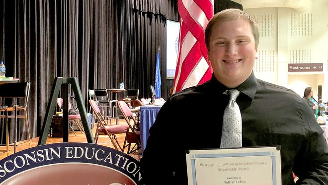 Nathan LeRoy poses with the scholarship award at the Wisconsin Education Association Council awards ceremony April 28, 2018, in La Crosse.