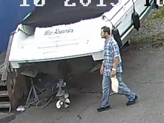 State Police released surveillance footage screenshots of the boat thief suspect.