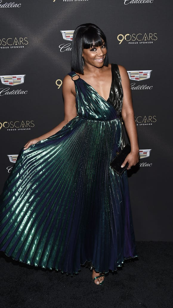 Tiffany Haddish struts in a peacock-green-and-blue