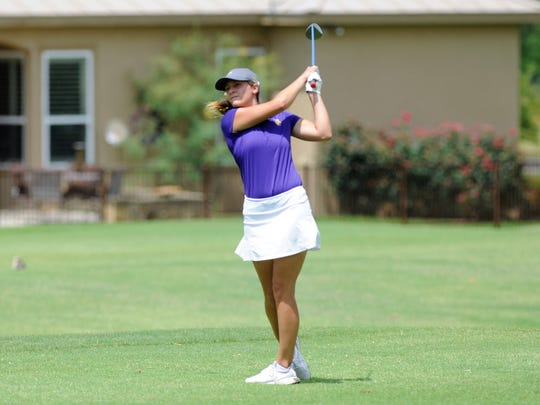 Wylie's Kaitlyn Harbin tees off at No. 11 during the first round of the UIL Class 4A state tournament. Harbin shot a first-round 103.