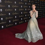 """Lily James has her Cinderella moment on the red carpet in an Elie Saab gown as she arrives for the premiere of her new movie, """"Cinderella,"""" on March 1 in Hollywood. The movie will be in theaters on March 13."""
