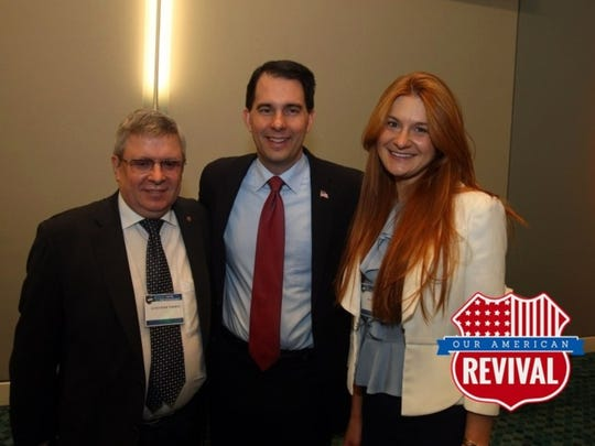 Gov. Scott Walker is pictured in 2015 with Alexander Torshin and Maria Butina. Butina was charged in July 2018 with attempting to help Russia interfere with U.S. politics.