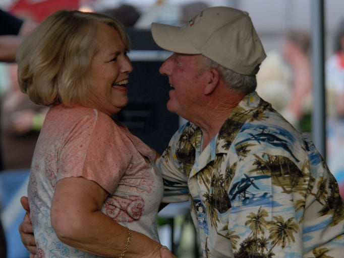 Brenda and Carl Ennis share a laugh while dancing at Eastern Shore's Own Arts Center's craft beer and music festival Saturday, Aug. 9, 2014 in Belle Haven. Proceeds from the event will benefit programs at ESO.