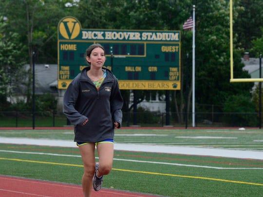 Senior drum major Sara Zuwiyya runs on the track at Vestal High School during cross-country practice.