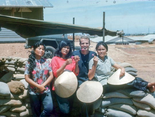 This photo of John Whitener with three Vietnamese women