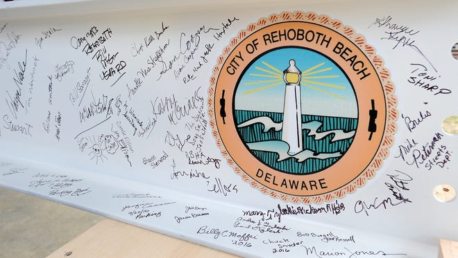 """Over a hundred residents and visitors along with 150 fifth-graders from Rehoboth Beach Elementary School gathered on Sept. 22 for the """"Beam Signing"""" that was held at the Rehoboth Beach City Hall Complex. The event allowed city officials and the public to sign the final beam to be installed in the new City Hall Building being constructed, which is due for completion in 2017."""
