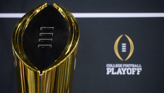 General view of the college football playoff trophy during media day at Phoenix Convention Center.
