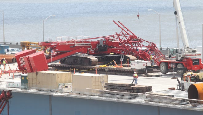 A crane working on the new Tappan Zee Bridge fell across all lanes of traffic July 19, 2016.