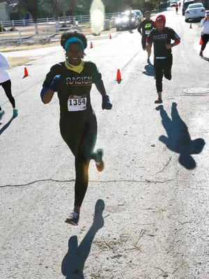Rosemary Baugh sprints to the finish line at Monday's Race Against Racism at the Mary Ann Dodson Camp in west El Paso. She finished the 5K race in 31 minutes and 24.4 seconds to finish fourth in her age group.