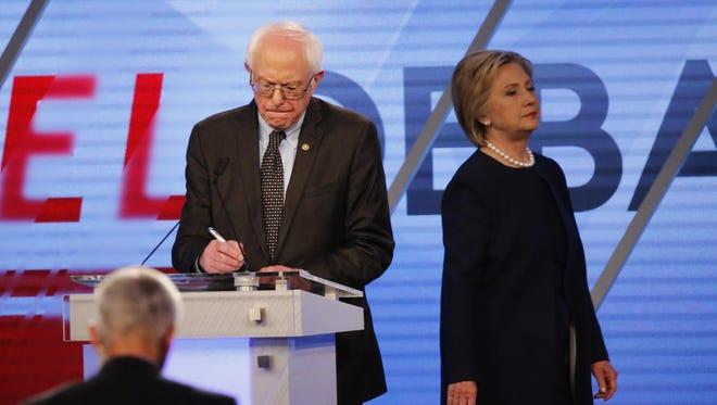 Bernie Sanders (left) and Hillary Clinton participate in the Democratic presidential debate on March 9, 2016, in Miami.