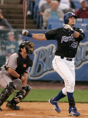 Clint Robinson hits a three-run homer for the Blue Rocks during a 2009 game at Frawley Stadium.