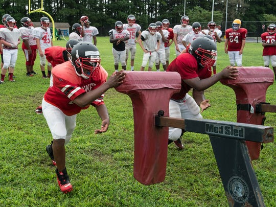 Two players practice a drill at James M. Bennett High School on Tuesday, Aug. 15, 2017.