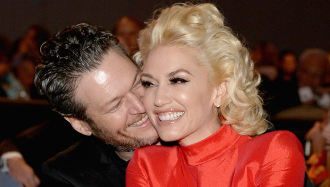Blake and Gwen snuggle at the pre-Grammys party.