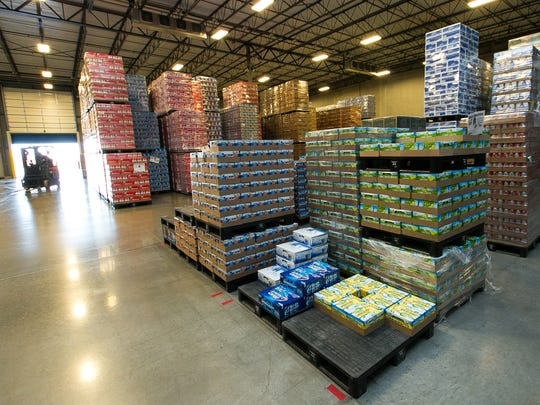 About 1000,000 cause of bear is stocked in the Controlled Environment Warehouse of Premier Distributing Center on Friday.