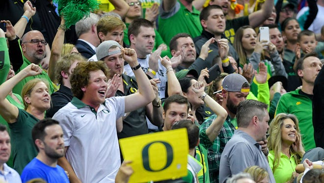 Mar 25, 2017; Kansas City, MO, USA; Oregon Ducks fans celebrate after the game against the Kansas Jayhawks in the finals of the Midwest Regional of the 2017 NCAA Tournament at Sprint Center. Oregon defeated Kansas 74-60. Mandatory Credit: Denny Medley-USA TODAY Sports