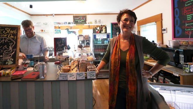 Carla Reid, owner of Black Dog Cafe, which will be celebrating its 20-year-anniversary on Saturday, Nov. 4, 2017, stands inside their newest location in Railroad Square.