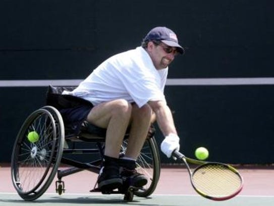Danny Heumann gives able-bodied tennis opponents a