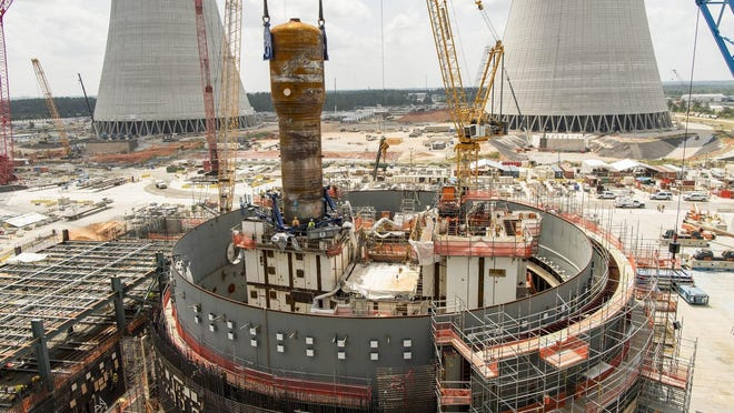 A 1.4 million-pound steam generator is lifted into place as work proceeds on two new nuclear reactors at Plant Vogle near Waynesboro, Ga.